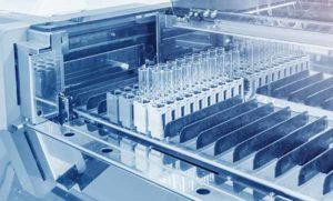 Filling vials using servo drive programmable i/o