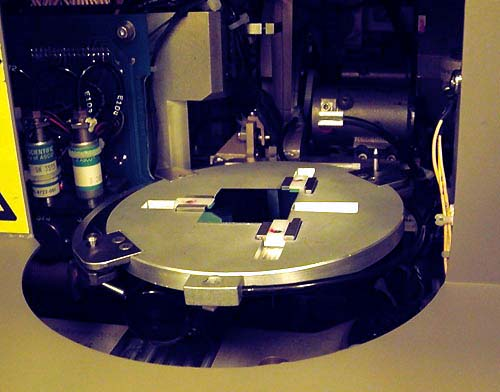 stepper machine moves the silicon wafer into position